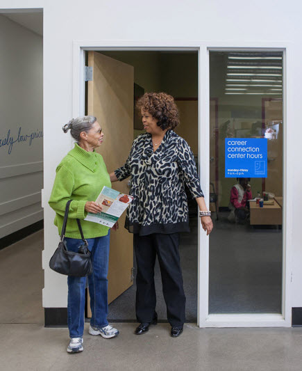 Veronica helping Winifred at the Career Connection Center in the community of Stapleton Denver, Colorado.