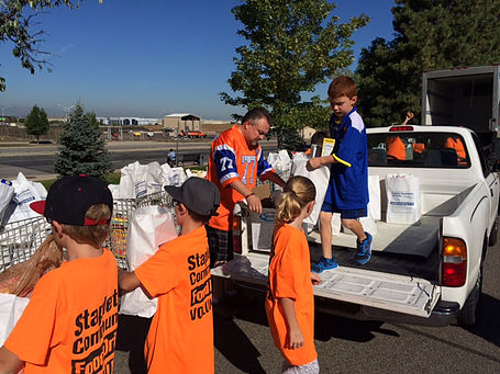 Kids helping at food drive